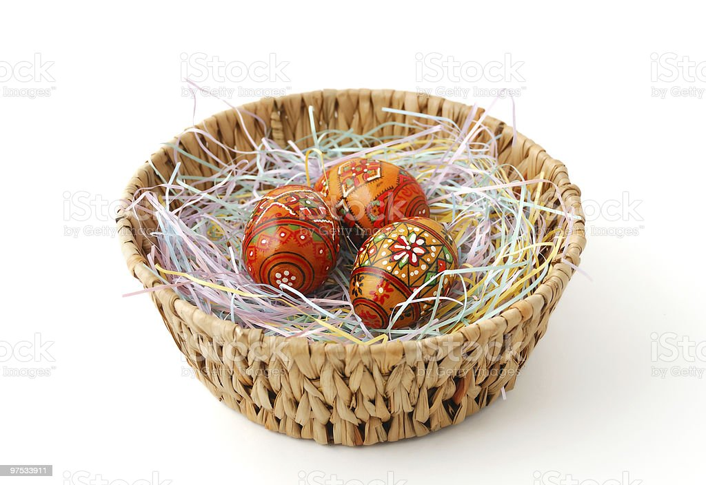 Easter basket with painted eggs stock photo