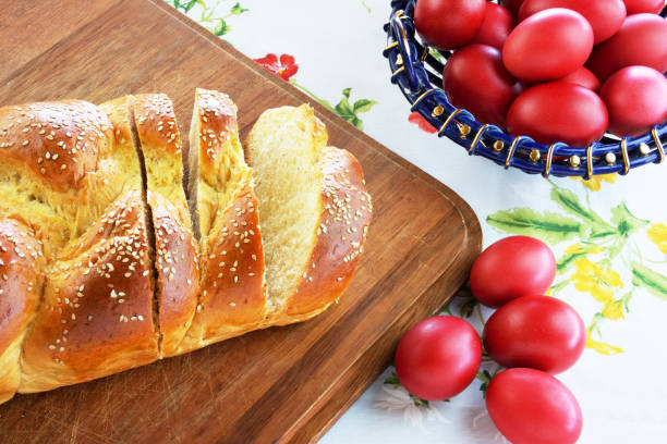 easter bread and red eggs - greek easter stock photos and pictures
