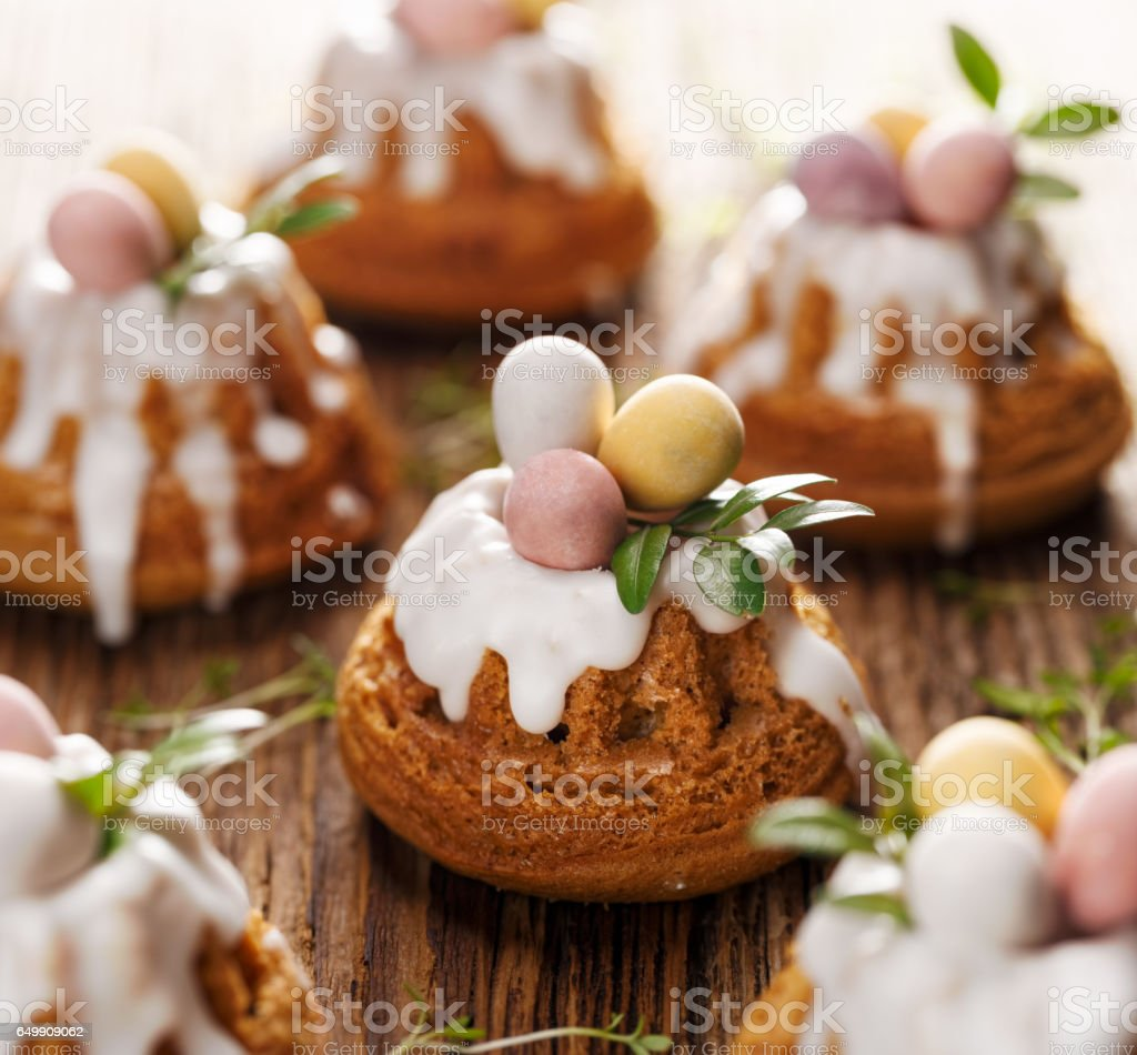 Easter Bundt Cakes Decorated With Icing And Chocolate Eggs Stock