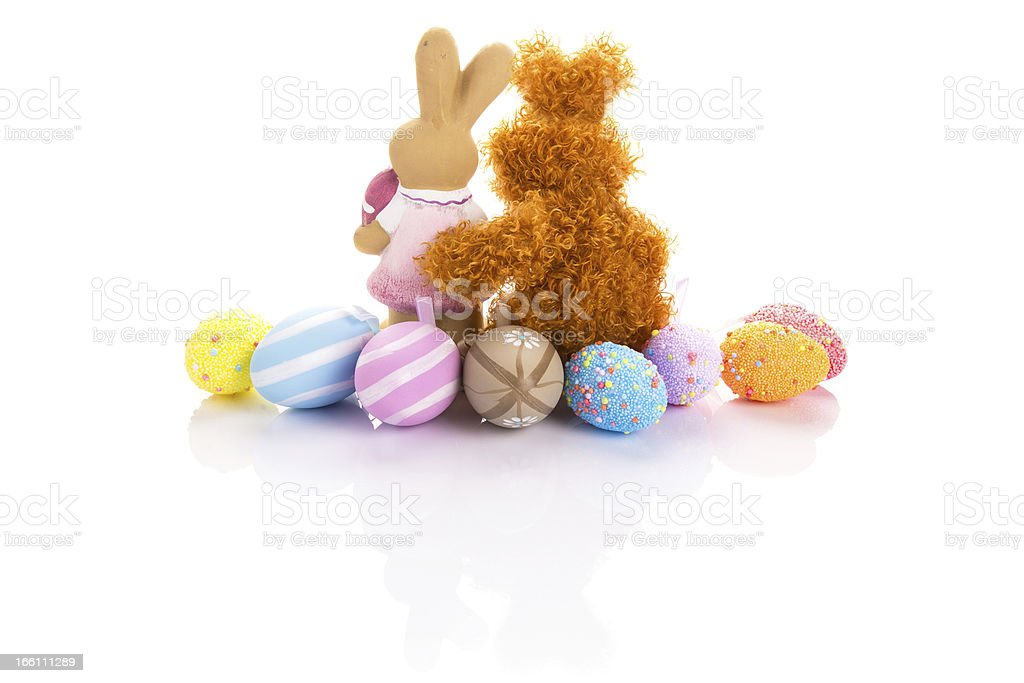 Easter bunnies in hug with colorful eggs royalty-free stock photo