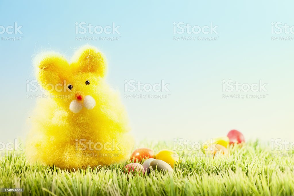 easter bunny and candy eggs on grass royalty-free stock photo
