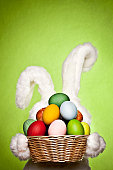 White bunny with basket in hands full of Easter eggs. Canon 1Ds Mark III