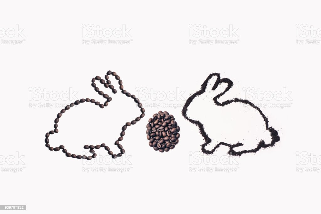 Easter bunny from coffee ground with egg on a white background stock photo