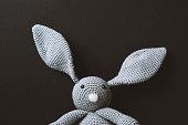 Handmade crocheted easter bunny on black background
