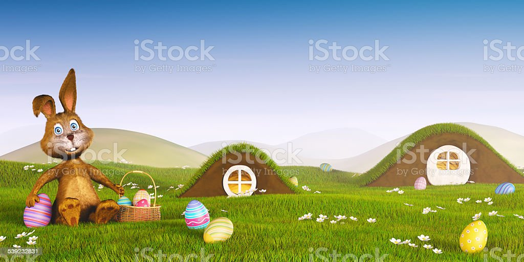 Easter bunny with a basket and eggs royalty-free stock photo