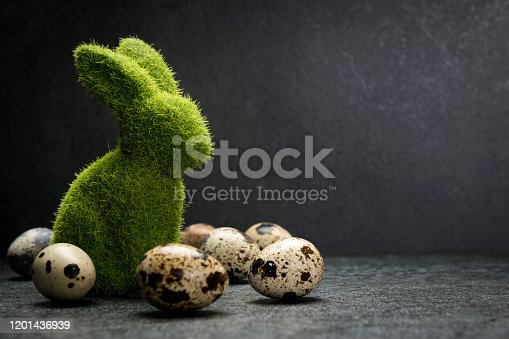 istock Easter bunny with easter eggs on white background 1201436939