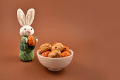 Easter bunny on a brown background. Spring decoration images. Easter concept. Cute white rabbit toy