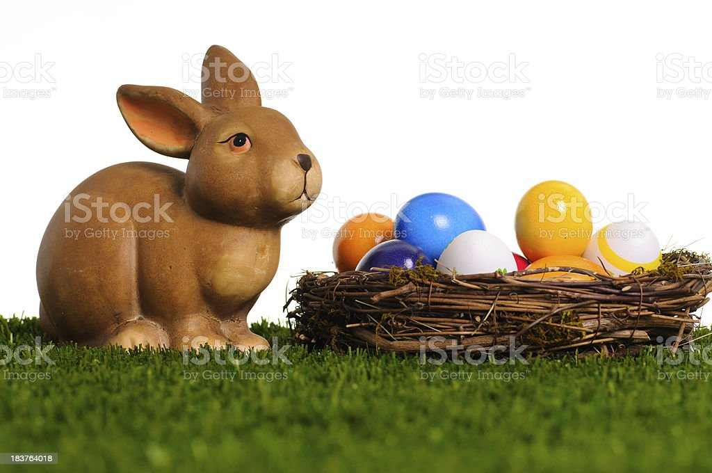 Easter bunny with nest royalty-free stock photo