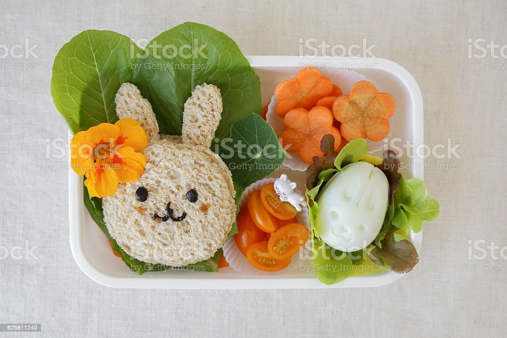 Easter Buny healthy lunch box, fun food art for kids stock photo