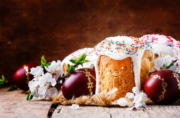 Easter cake and red painted eggs, white apricot flowers stock photo