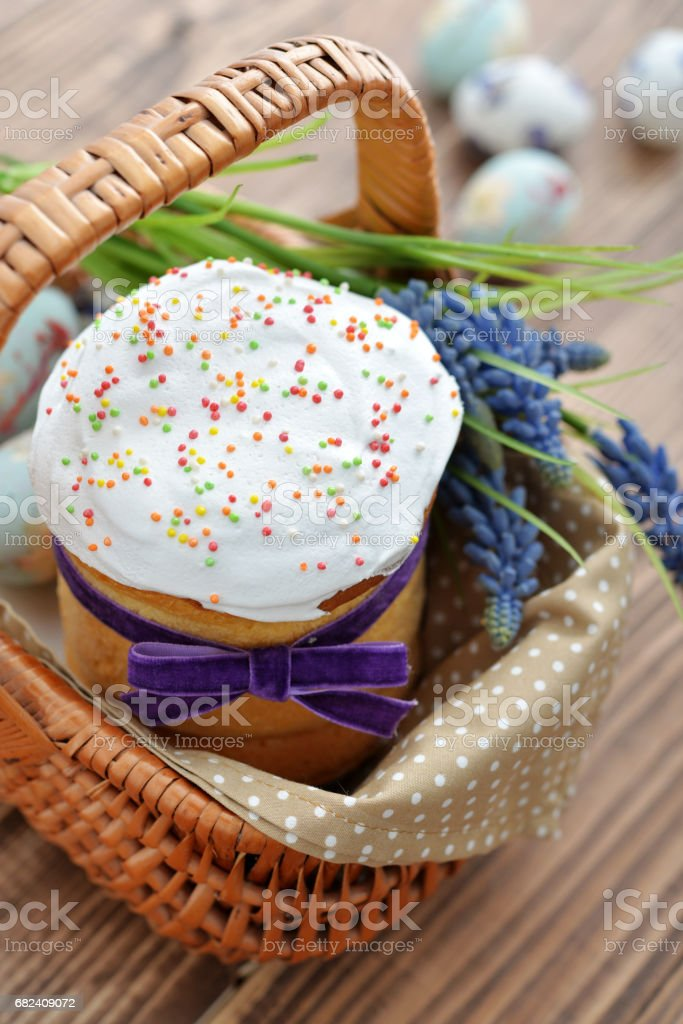 Easter cake in wicker basket royalty-free stock photo