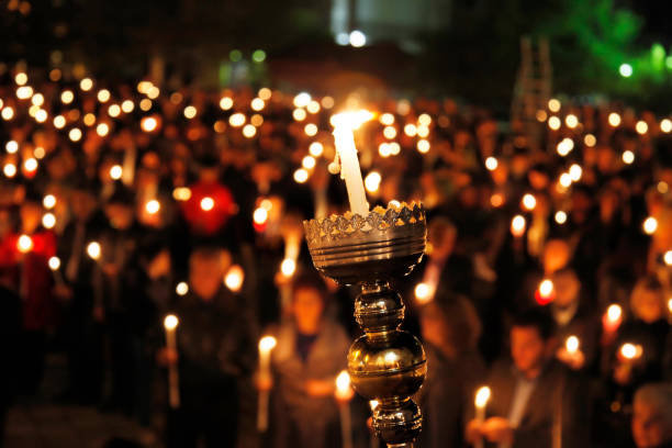 easter candle vigil - greek easter stock photos and pictures