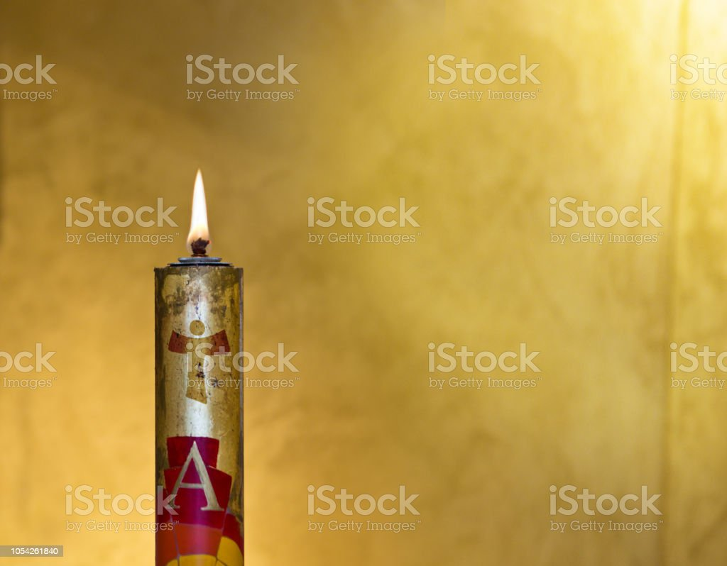 Easter candle welcomes the light of the holy spirit stock photo