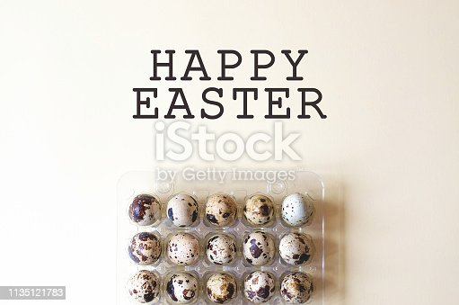 1147995495 istock photo Easter card with a plastic case with quail eggs. 1135121783