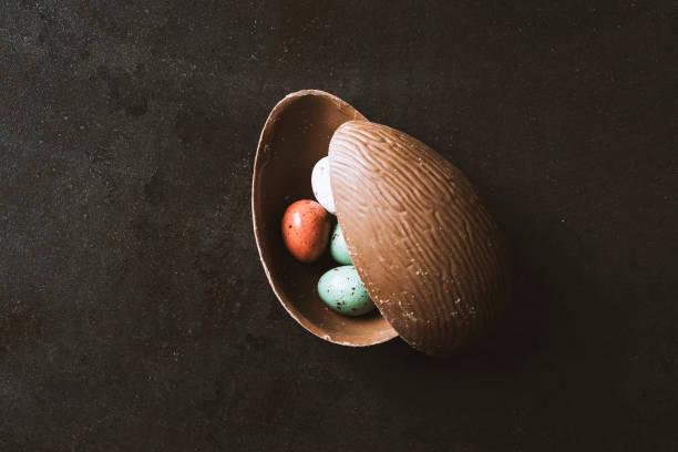 Easter chocolate egg on black background stock photo