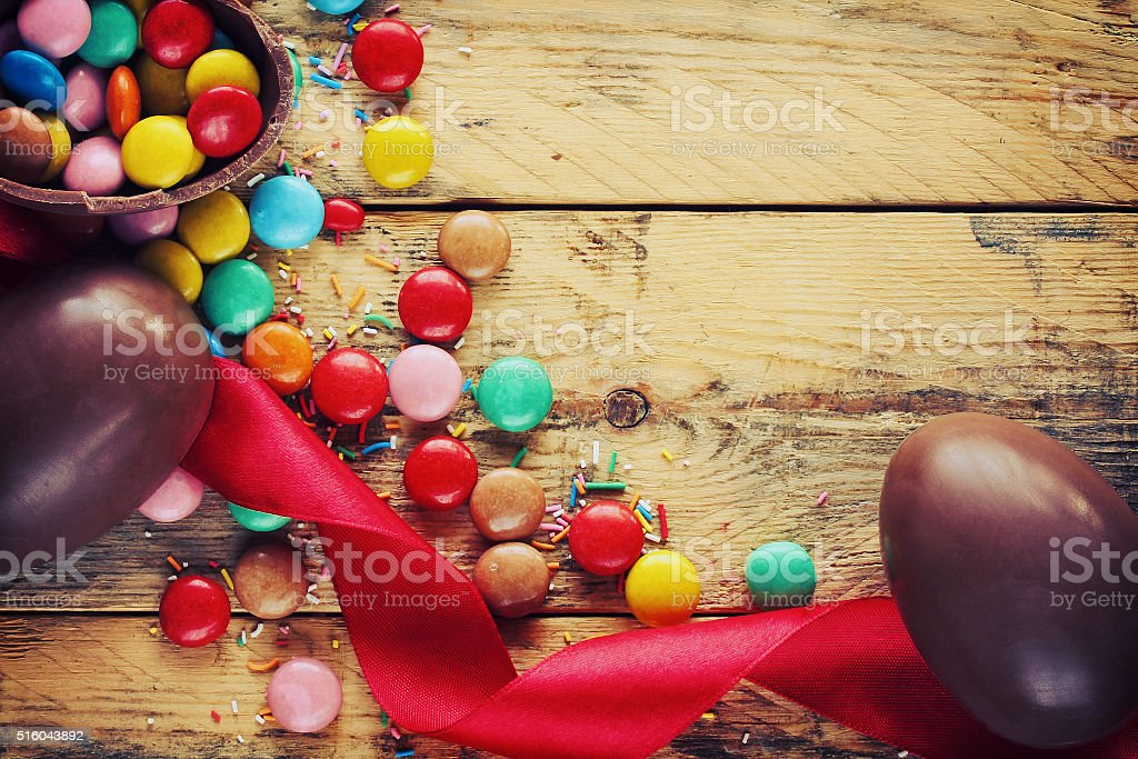 Easter chocolate eggs, candy, red ribbon stock photo