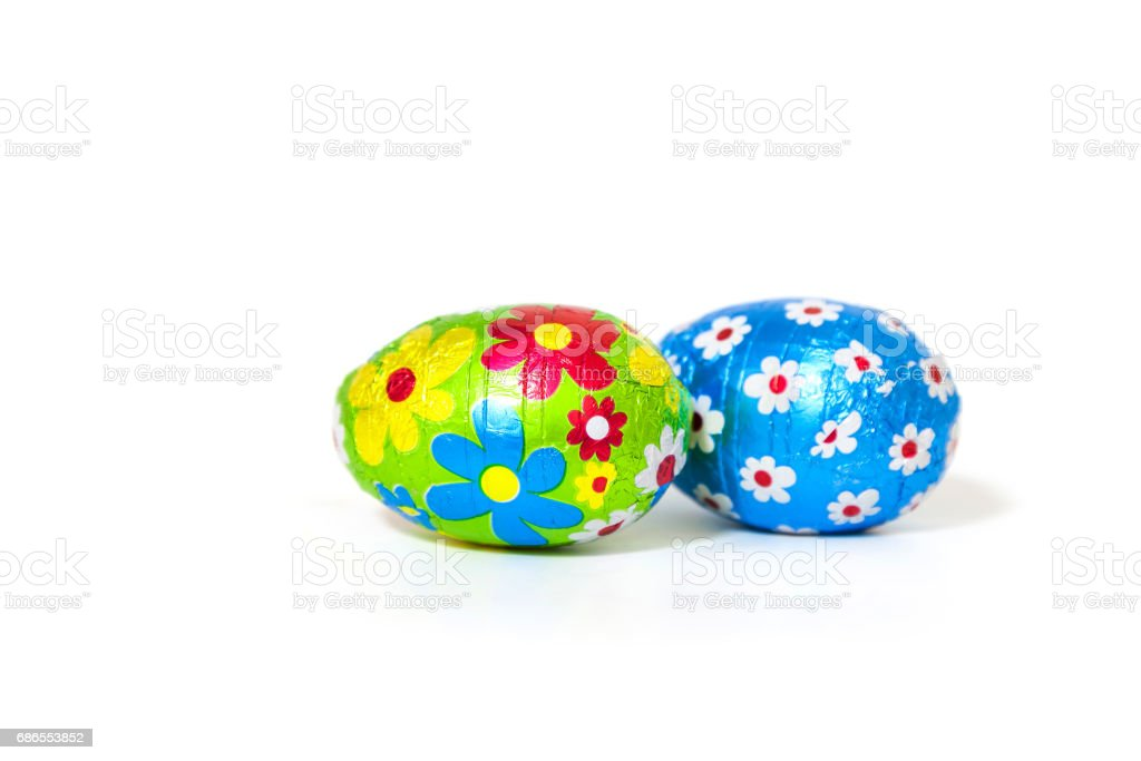 Easter Chocolate Eggs Wrapped with Colored Foil on white Background. royaltyfri bildbanksbilder