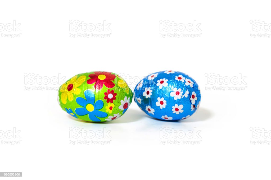 Easter Chocolate Eggs Wrapped with Colored Foil on white Background. zbiór zdjęć royalty-free