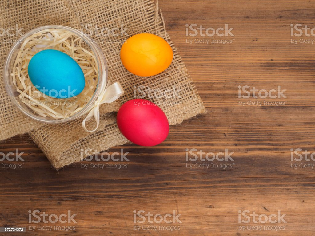Easter Colored Egg On Burlap And Old Wooden Texture Table Mock Up