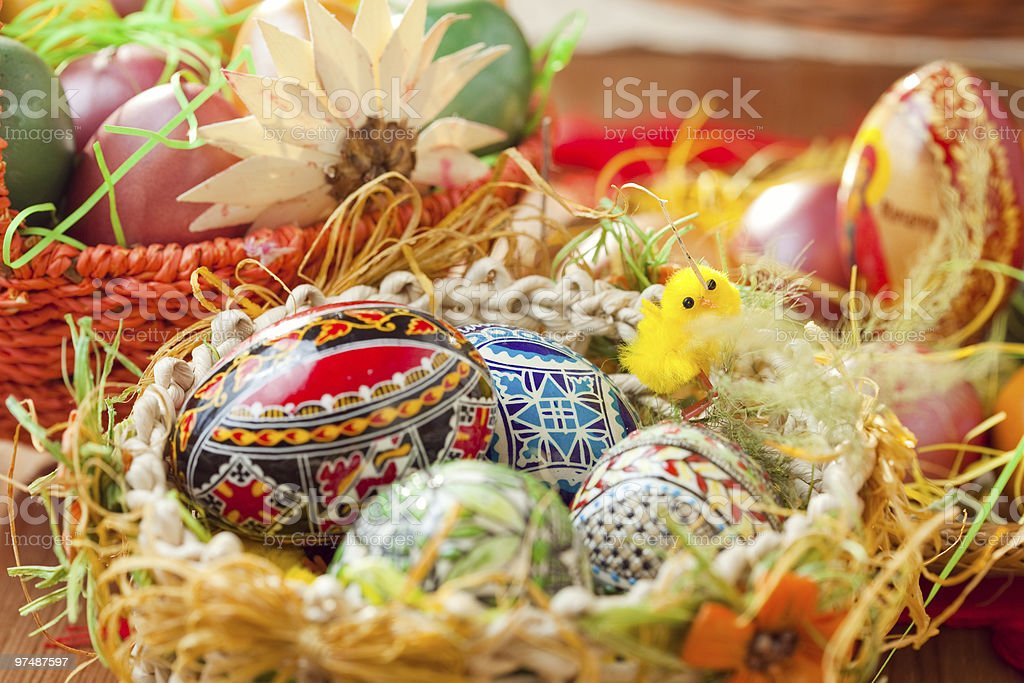 Easter colorful eggs in traditional basket royalty-free stock photo