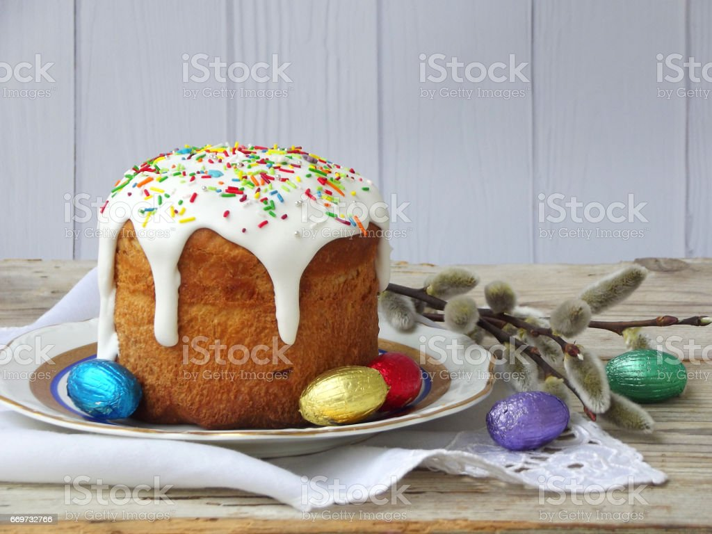 Easter composition of sweet bread, paska and eggs on wooden background. Orthodox kulich. Holidays breakfast concept with space for text stock photo