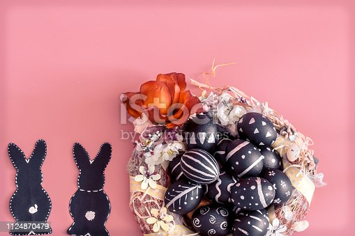 istock Easter composition with eggs and the Easter Bunny on a pink background 1124870479
