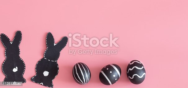 istock Easter composition with eggs and the Easter Bunny on a pink background 1125136087