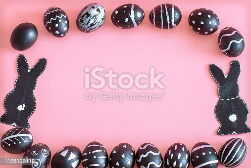 istock Easter composition with eggs and the Easter Bunny on a pink background 1125136116
