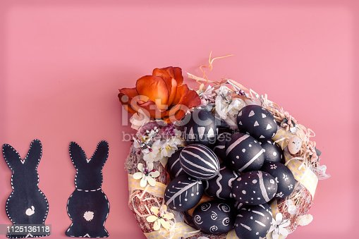 istock Easter composition with eggs and the Easter Bunny on a pink background 1125136118