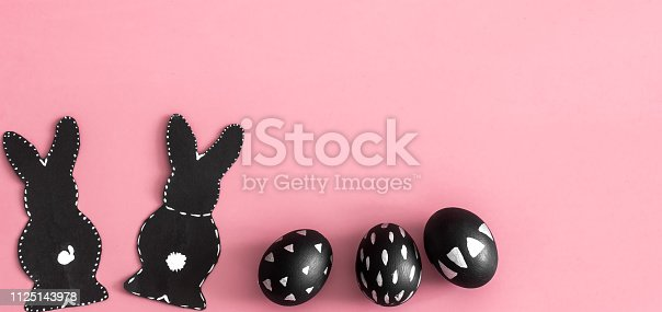 istock Easter composition with eggs and the Easter Bunny on a pink background 1125143978