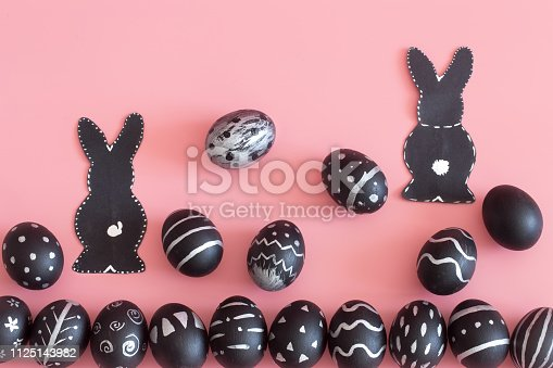 istock Easter composition with eggs and the Easter Bunny on a pink background 1125143982