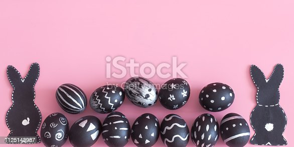 istock Easter composition with eggs and the Easter Bunny on a pink background 1125143987