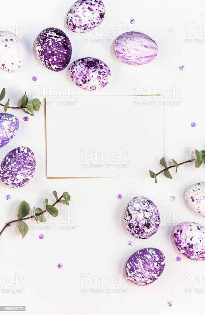 Easter composition with lilac marble eggs, sequins and silk ribbons on a white background. Space for a greeting text. Easter, spring concept, template cards. Flat lay, top view. stock photo