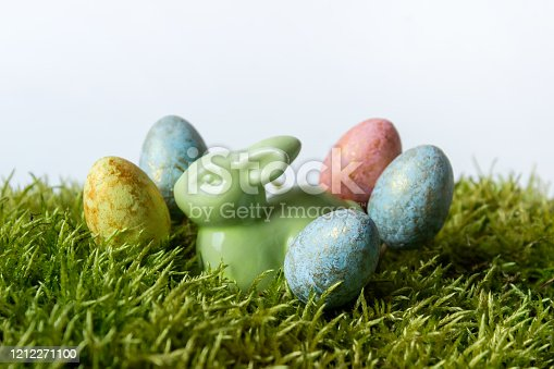 930928526 istock photo Easter composition with porcelein bunny rabbit and eggs 1212271100