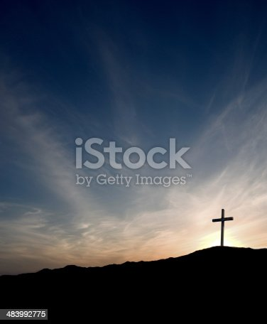 At sunrise, the Easter morning cross. The sun is rising behind the cross.