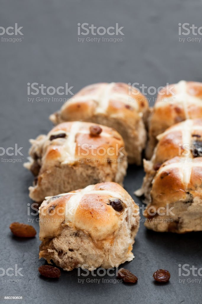 Easter  cross buns and sultanas on black stone background stock photo