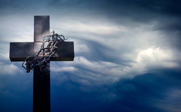 Easter cross with crown of thorns against blue sky abstract background with empty space stock photo