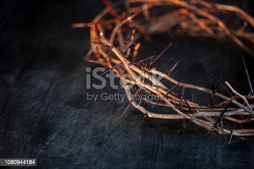 Easter Crown of thorns with texture on an old black wood background