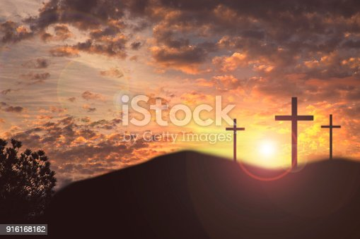 Easter themes with three cross on a hill representing the crucifixion event in Christian history.