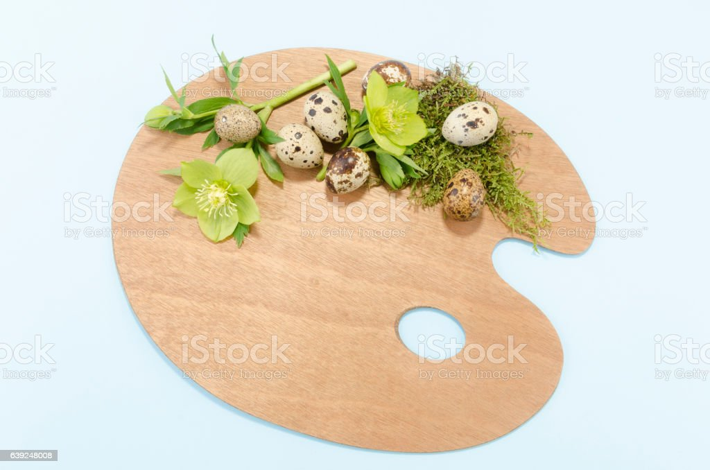 Easter decoration on a blue background with quail eggs and stock photo