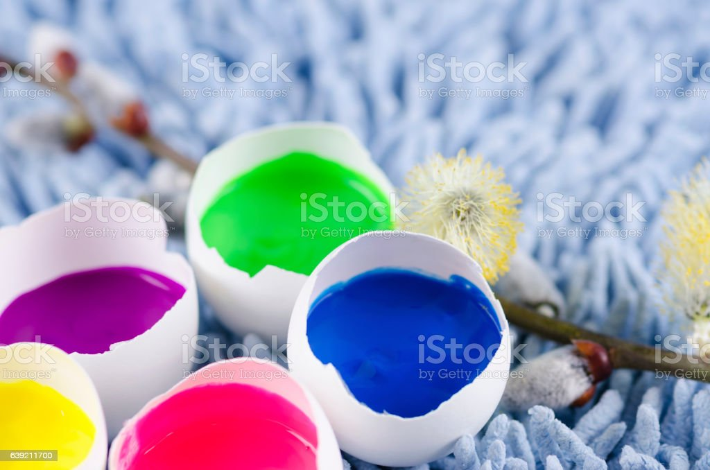 Easter decoration with egg shells and filled with tempera paints stock photo