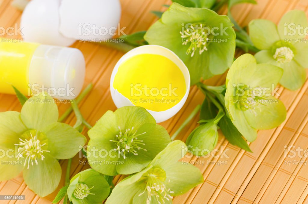 Easter decoration with egg shells on a yellow pad plus stock photo