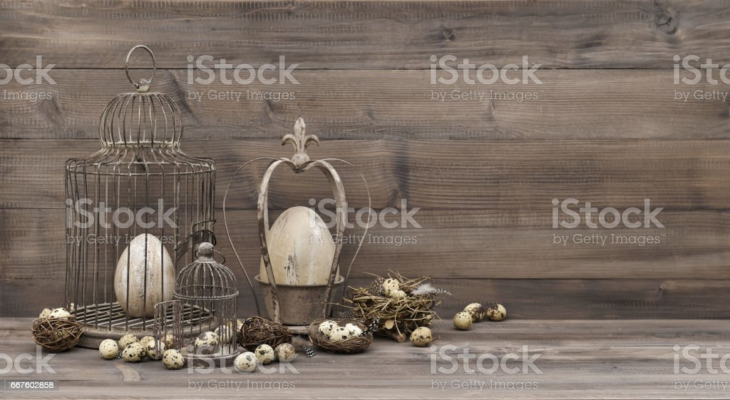 Easter decoration with eggs nest birdcage vintage stock photo