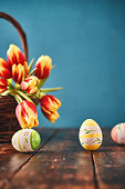 Easter Decoration with Tulips and Easter Eggs on Rustic Background