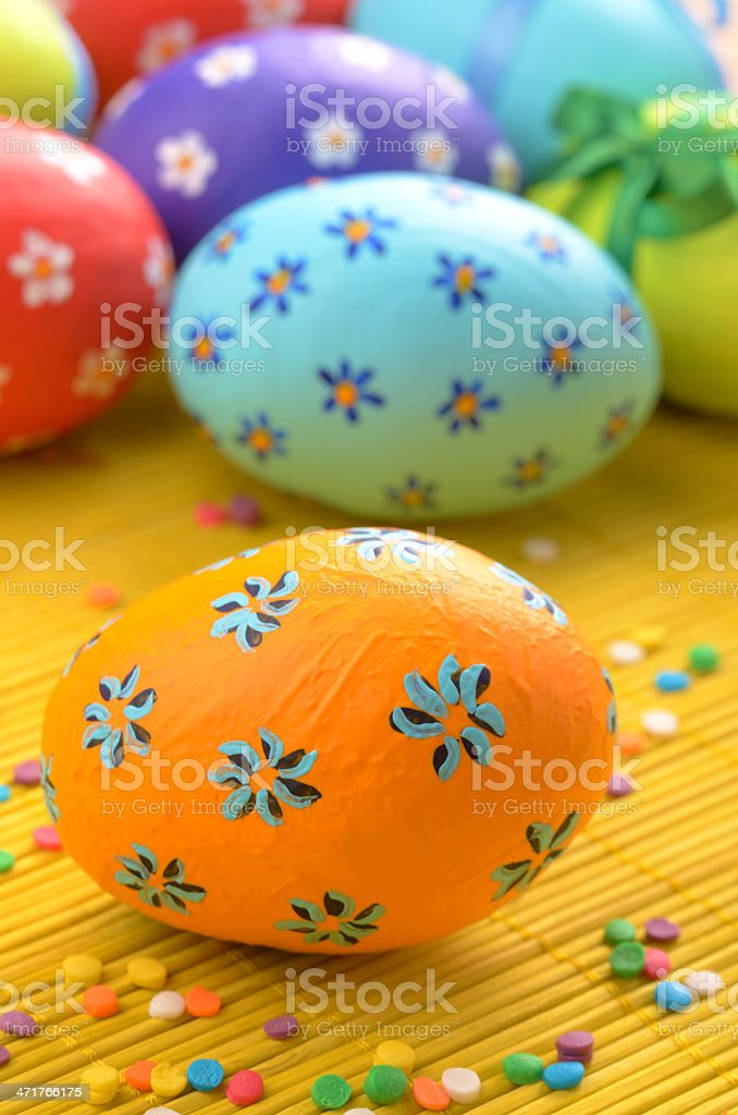 Easter decorations - eggs with painted flowers on the tabletop royalty-free stock photo