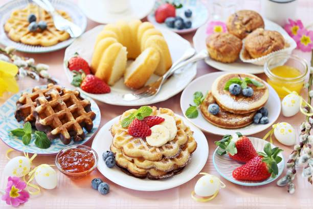 easter dessert table. pancakes,waffles and bundt cake with fresh berries and various of topping. - easter brunch stock photos and pictures