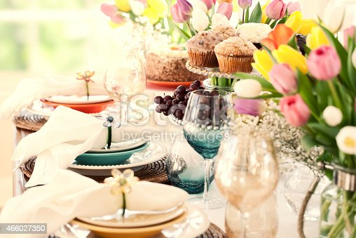 istock Easter dining table, bouquet of tulips and lovely place setting 466027350