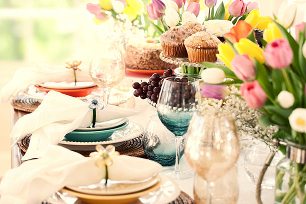 easter dining table, bouquet of tulips and lovely place setting - easter brunch stock photos and pictures