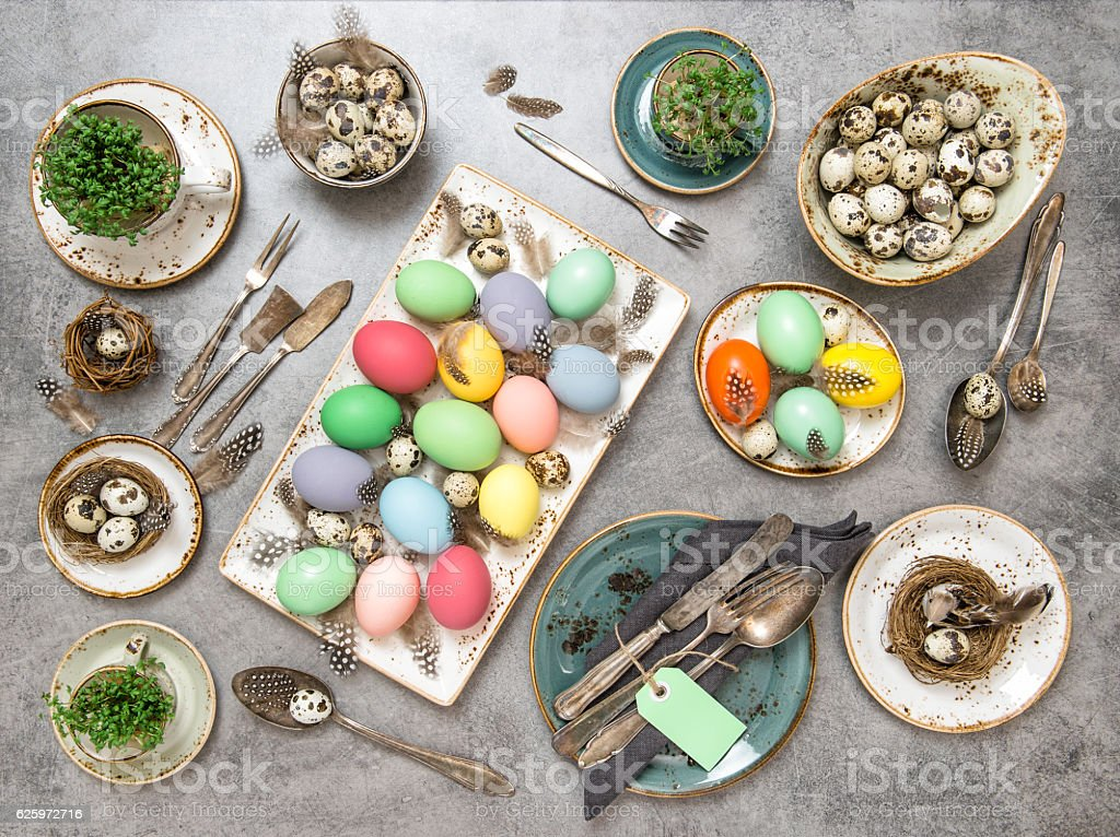 Easter dinner decorations colored eggs Flat lay stock photo