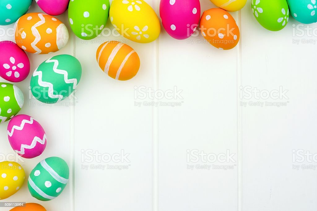 Easter egg corner border over white wood stock photo